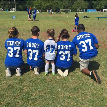 People are loving this sweet photo of a little girl's blended family at her soccer game