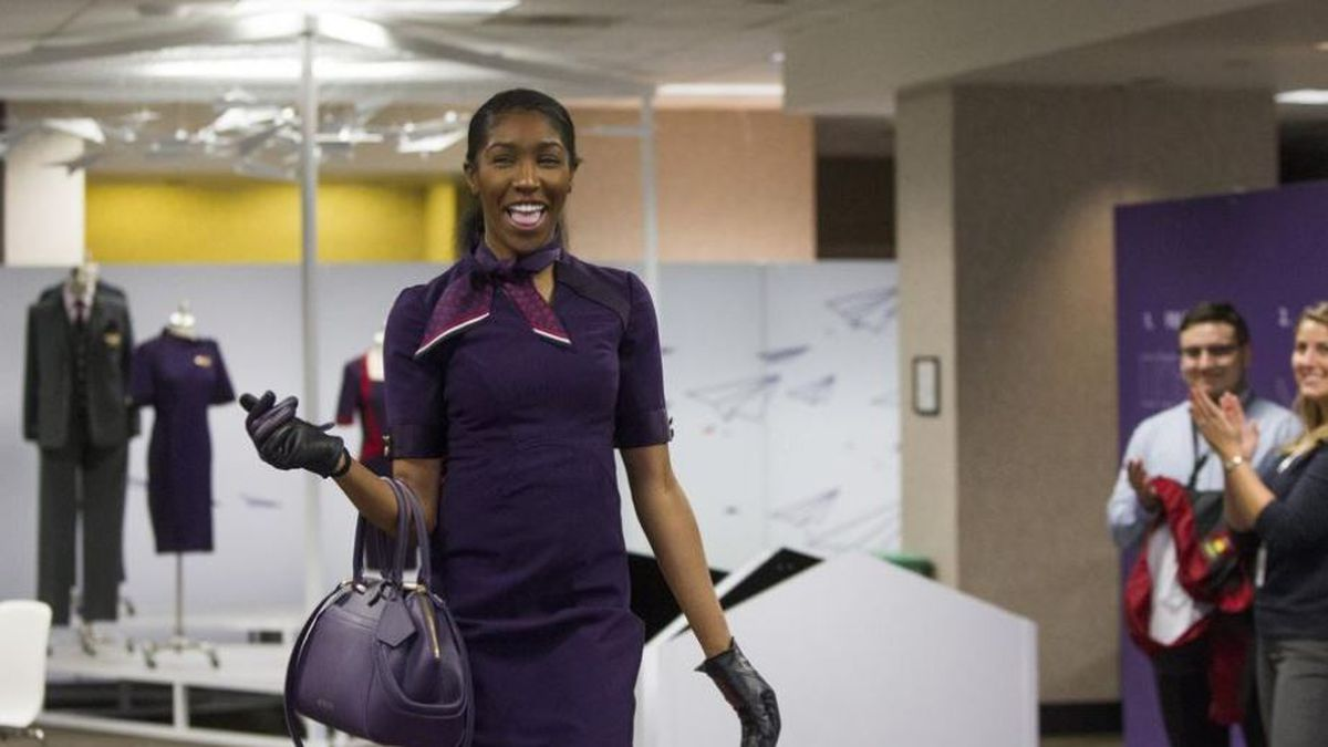 Delta debuts uniforms in 'Passport Plum' with launch Tuesday