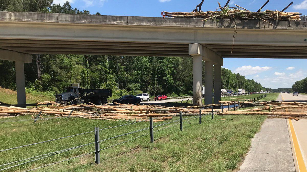 Log truck overturns on bridge, closing I-575 in both directions