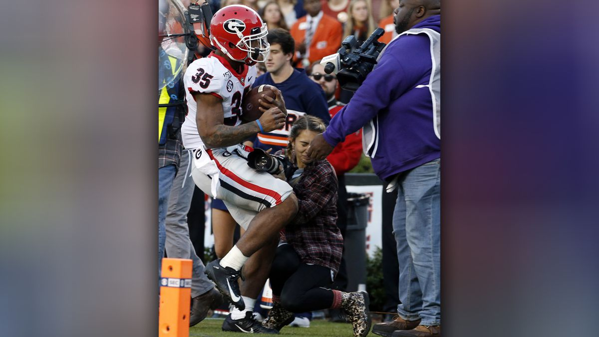 UGA photography intern taken off field on stretcher after sideline collision