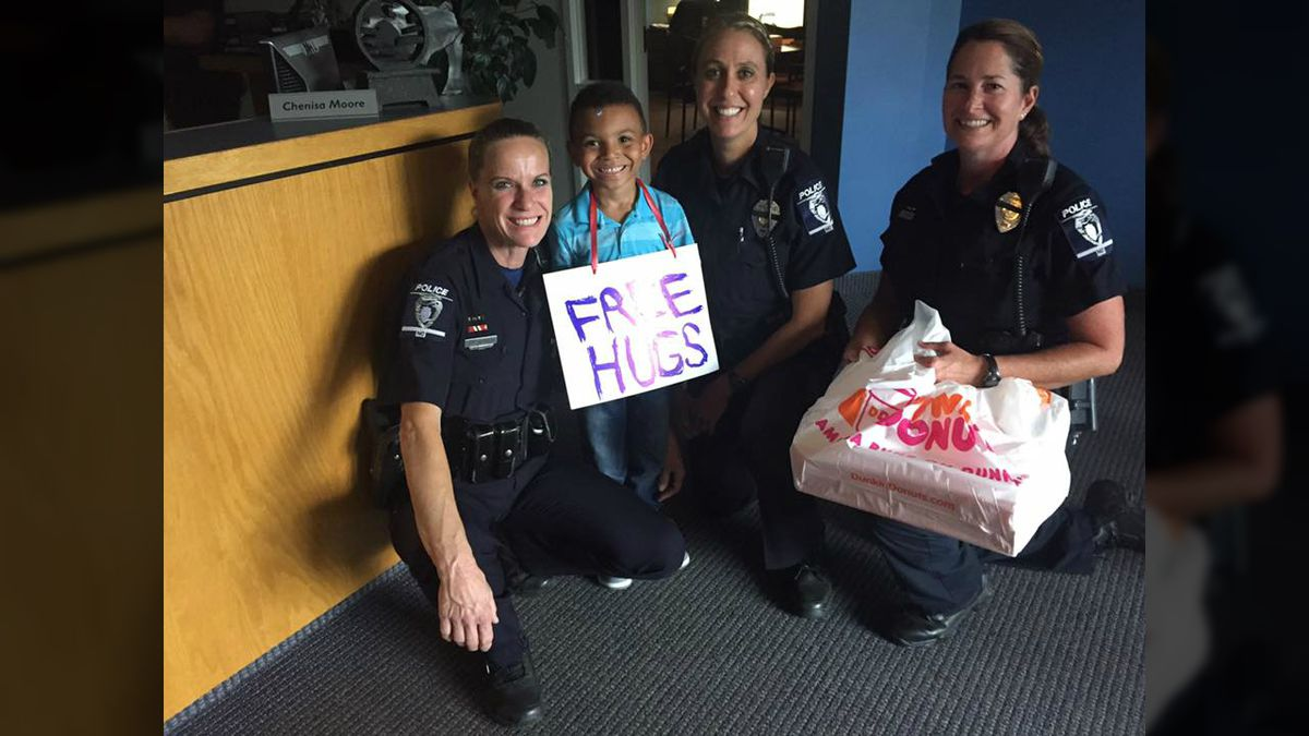 Little boy gives free hugs and donuts to officers in Charlotte