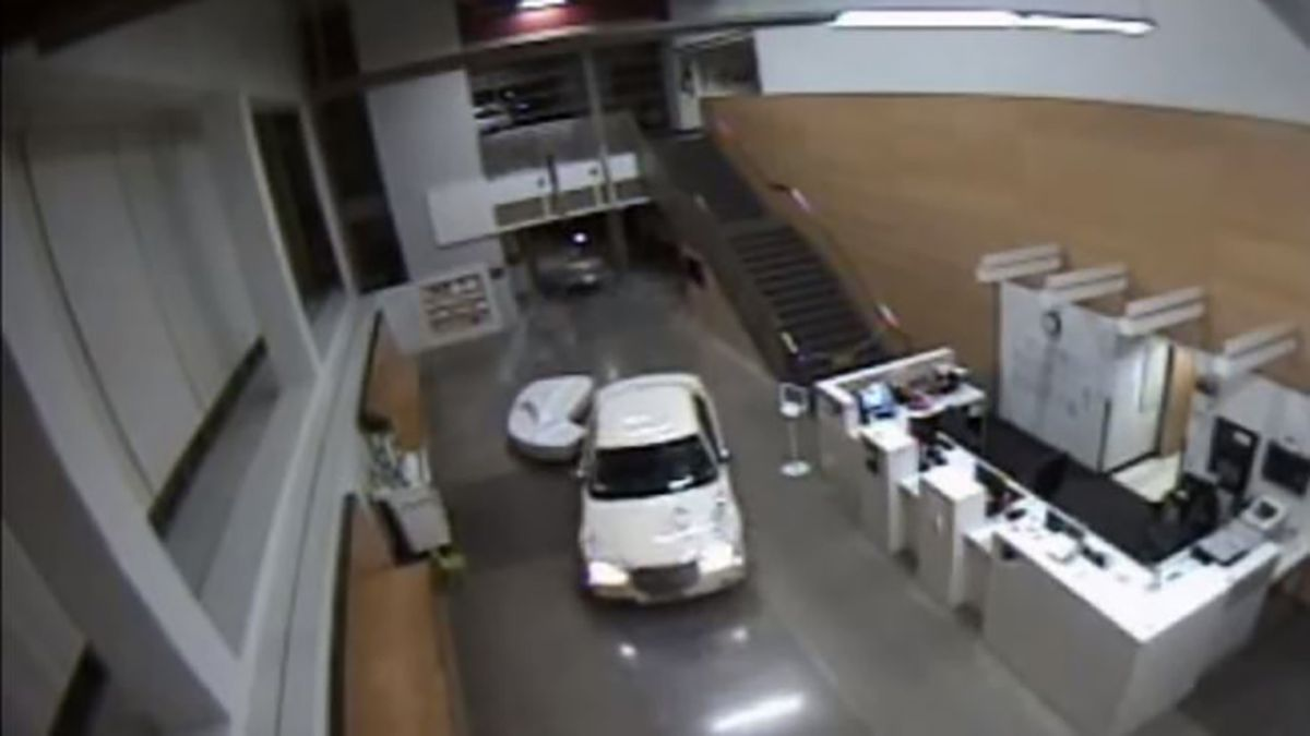 Woman with baby in car crashes through front of police station, tries to back out