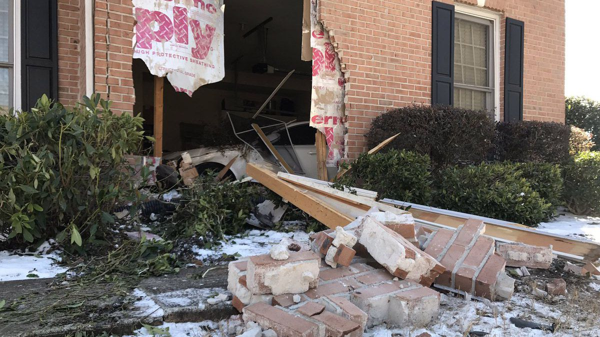 SUV crashes into home with family inside after accident involving ice